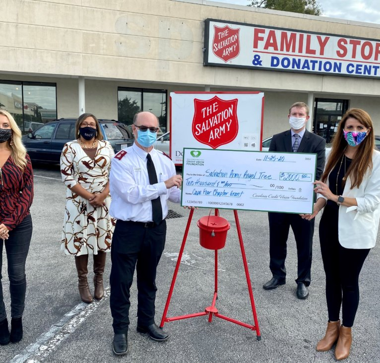 Men and women standing next to Salvation Army Family Store